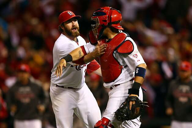 ST LOUIS, MO - OCTOBER 17:  Jason Motte #30 and catcher Yadier Molina #4 of the St. Louis Cardinals celebrate the Cardinals 3-1 victory against the San Francisco Giants in Game Three of the National League Championship Series at Busch Stadium on October 17, 2012 in St Louis, Missouri.  (Photo by Elsa/Getty Images) Photo: Elsa, Getty Images