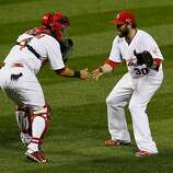 ST LOUIS, MO - OCTOBER 17:  Jason Motte #30 and catcher Yadier Molina #4 of the St. Louis Cardinals celebrate the Cardinals 3-1 victory against the San Francisco Giants in Game Three of the National League Championship Series at Busch Stadium on October 17, 2012 in St Louis, Missouri.  (Photo by Kevin C. Cox/Getty Images)