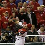 St. Louis Cardinals catcher Yadier Molina (4) reaches over to catch a fly ball hit by by San Francisco Giants' Aubrey Huff (17) during the eighth inning of Game 3 of baseball's National League championship series, Wednesday, Oct. 17, 2012, in St. Louis. (AP Photo/David J. Phillip)