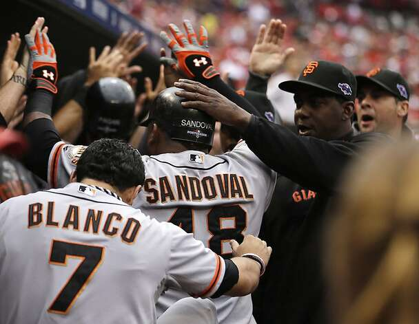 San Francisco Giants' Pablo Sandoval (48) celebrates a run as he walks into the dugout during the third inning of Game 3 of baseball's National League championship series against the St. Louis Cardinals  Wednesday, Oct. 17, 2012, in St. Louis. (AP Photo/Jeff Roberson) Photo: Jeff Roberson, Associated Press