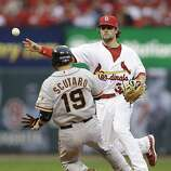 St. Louis Cardinals shortstop Pete Kozma (38) throws to first for a double play, taking San Francisco Giants' Marco Scutaro (19) out at second and Pablo Sandoval (48) out at first during the fourth inning of Game 3 of baseball's National League championship series Wednesday, Oct. 17, 2012, in St. Louis. (AP Photo/David J. Phillip)
