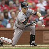 San Francisco Giants' Matt Cain (18) bunts the ball to advance Brandon Crawford to second base during the fourth inning of Game 3 of baseball's National League championship series against the St. Louis Cardinals, Wednesday, Oct. 17, 2012, in St. Louis. (AP Photo/David J. Phillip)