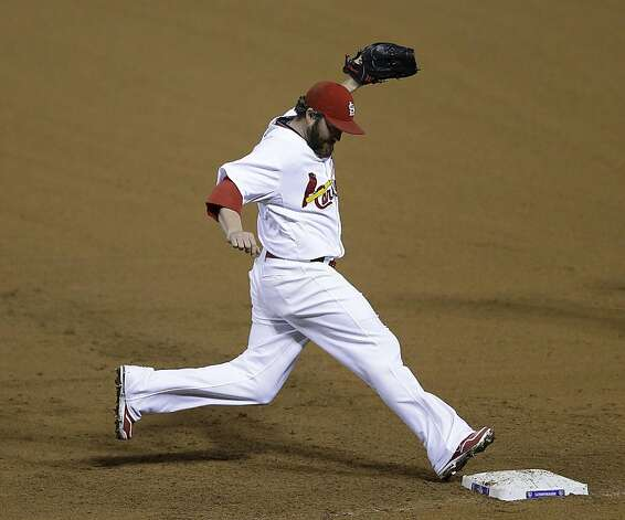 St. Louis Cardinals relief pitcher Jason Motte (30) forces out San Francisco Giants' Marco Scutaro (19) at first base during the ninth inning of Game 3 of baseball's National League championship series, Wednesday, Oct. 17, 2012, in St. Louis. (AP Photo/Patrick Semansky) Photo: Patrick Semansky, Associated Press