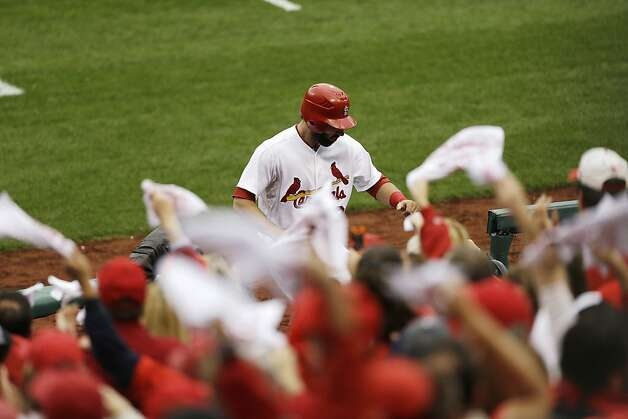 St. Louis Cardinals'  Matt Carpenter (13) celebrates his two-run home run as he walks back to the dugout during the third inning of Game 3 of baseball's National League championship series against the San Francisco Giants, Wednesday, Oct. 17, 2012, in St. Louis. (AP Photo/Patrick Semansky) Photo: Patrick Semansky, Associated Press