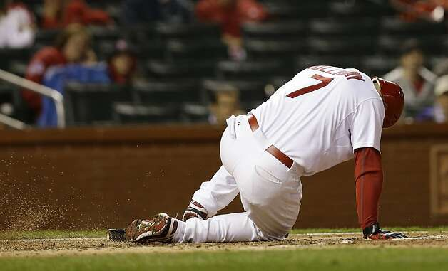 St. Louis Cardinals' Matt Holliday (7) goes down after fouling the ball off of his leg during the eighth inning of Game 3 of baseball's National League championship series against the San Francisco Giants, Wednesday, Oct. 17, 2012, in St. Louis. (AP Photo/David J. Phillip) Photo: David J. Phillip, Associated Press