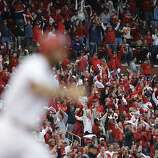 Fans celebrate after Cardinals' Matt Carpenter (foreground) hit a two-run home run in the third inning against the San Francisco Giants in Game 3 of the National League Championship Series at Busch Stadium in St. Louis, Missouri, Wednesday, October 17, 2012. (Chris Lee/St. Louis Post-Dispatch/MCT)