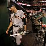 Giants' Hunter Pence walks to the clubhouse after  San Francisco lost to the St. Louis Cardinals 3-1 in game three of the National League Championship Series, on Wednesday Oct. 17, 2012, at Busch Stadium, in  St. Louis, Mo.