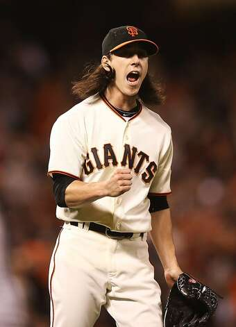 Tim Lincecum of the San Francisco Giants celebrates after David Freese of the St. Louis Cardinals hits into a double play in the fifth inning of Game One of the National League Championship Series at AT&T Park on October 14, 2012 in San Francisco, California. Photo: Ezra Shaw, Getty Images