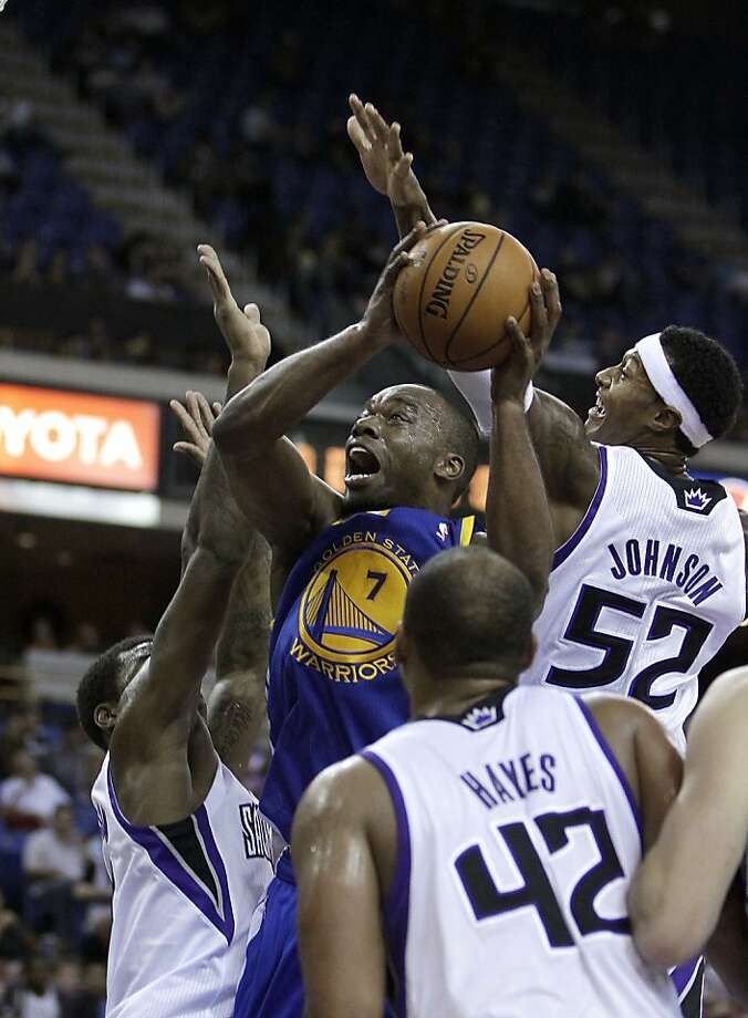 The Warriors' Carl Landry tries to maneuver to the basket at Sacramento. He had points and nine rebounds. Photo: Rich Pedroncelli, Associated Press