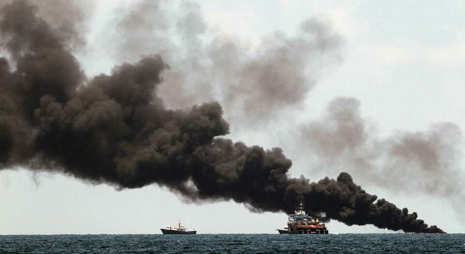 Vessels monitor a oil burn in the area of the Deepwater Horizon disaster on the Gulf of Mexico, Tues