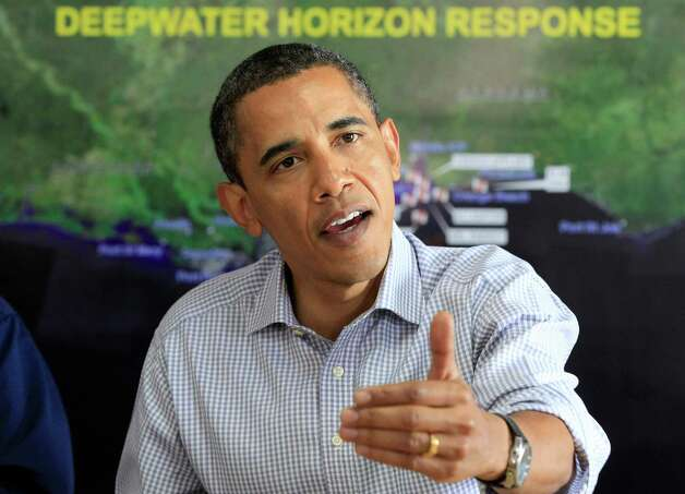 President Barack Obama makes a statement after being briefed on the BP oil spill relief efforts in the Gulf Coast region, Friday, June 4, 2010, at Louis Armstrong International New Orleans Airport in Kenner, La. (AP Photo/Charles Dharapak) Photo: Charles Dharapak, AP / AP