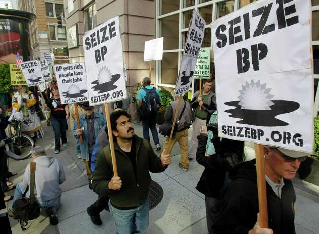 Protesters gather outside of the BP offices in San Francisco on Wednesday, May 12, 2010 to demonstrate against the Gulf oil rig disaster. (AP Photo/Marcio Jose Sanchez) Photo: Marcio Jose Sanchez, AP / AP