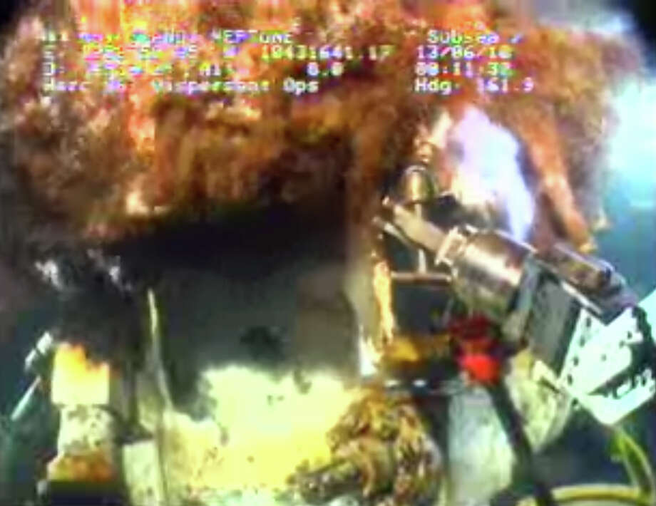 This image from video provided by BP PLC early Sunday morning, June 13, 2010 shows oil continuing to pour out at the site of the Deepwater Horizon oil well in the Gulf of Mexico. The Coast Guard has demanded that BP step up its efforts to contain the oil gushing into the Gulf of Mexico by the end of the weekend, telling the British oil giant that its slow pace in stopping the spill is becoming increasingly alarming as the disaster fouled the coastline in ugly new ways Saturday.  (AP Photo/BP PLC) NO SALES Photo: AP / BP PLC