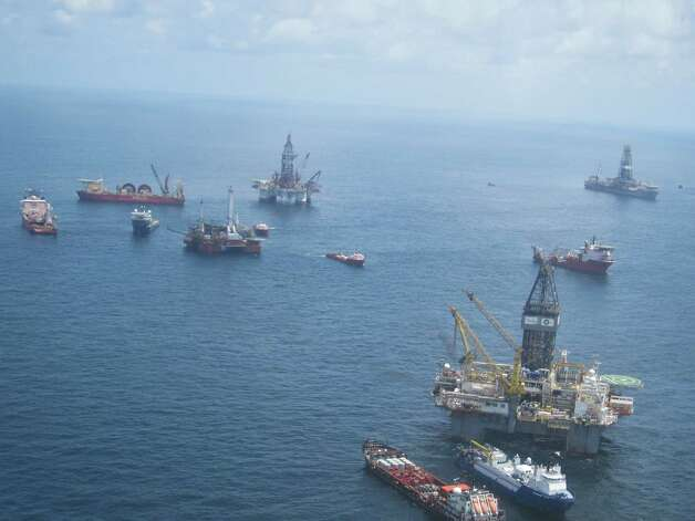 The view from an approaching helicopter shows the armada of drillships and other vessels surrounding the site of the blown out BP well in the Gulf of Mexico about 40 miles off the coast of Louisiana. Credit Brett Clanton / Chronicle / DirectToArchive