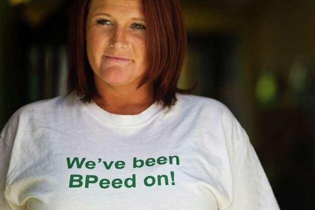 "Hairdresser Karen Jackson wears a t-shirt that reads ""We've been BPeed on!"" on the front of the shirt and ""Gulf Oil Disaster 2010-??"" on the back Saturday, July 3, 2010, in Orange Beach, Ala. Jackson says she is worried about the effect the spill is having on her community and what will happen if local business continues to falter.  ""I would hate to have to leave this place.  We love it here."" She said her business is way off what it should be for the season, ""down here we make all of our money in the summer,"" she says.  Her husband's work as an electrician has dried up she says, so he has signed on to work cleanup for BP. ( Smiley N. Pool / Houston Chronicle ) Photo: Smiley N. Pool, Houston Chronicle / Houston Chronicle"
