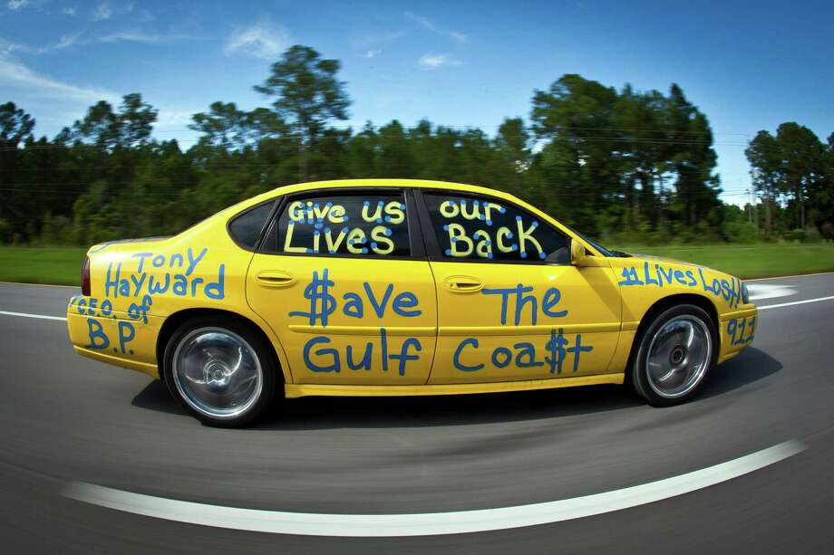 "A driver rolls down the highway with messages such as ""$ave the Gulf Coa$t""  and ""Tony Hayward C.E. O of B.P. Give us out Live Back"" while driving Sunday, June 27, 2010, in Pensacola, Florida.  ( Smiley N. Pool / Houston Chronicle ) Photo: Smiley N. Pool, Houston Chronicle / Houston Chronicle"
