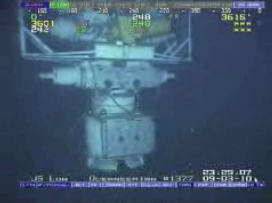 In this image taken from video provided by BP  PLC at 12:23 a.m. EDT, Saturday Sept. 4, 2010 Aug. 3, 2010 shows the blowout preventer that failed to stop oil from spewing into the Gulf of Mexico being raised to the surface. The blowout preventer wasn't expected to reach the surface until Saturday, at which point government investigators will take possession of it. (AP Photo/BP PLC) NO SALES Photo: AP / BP PLC