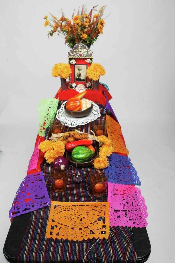 Step 4: Collect items that symbolize your loved one, such as favorite foods, items from a favorite sports team or CDs from a favorite musician. Also get tablecloths and long scarves to cover the tabletop where you'll be placing the box. Other things to include are traditional Día de los Muertos items that represent the four basic elements of an altar: candles for fire; pan de muerto and marigolds for earth; papel picado for wind and glasses of water, which symbolize purity and renewal. Photo: HELEN L. MONTOYA, SAN ANTONIO EXPRESS-NEWS / hmontoya@conexionsa.com