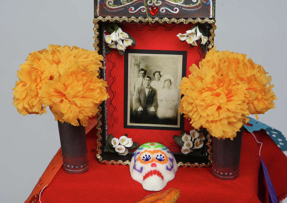 Step 6:Place the altar box at the top level as the centerpiece. Line the path to it with the items you've collected. Candles are placed all over the altar to help guard the dead on their return, says Muraida. Photo: HELEN L. MONTOYA, SAN ANTONIO EXPRESS-NEWS / hmontoya@conexionsa.com