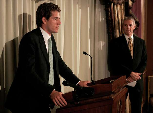 Cameron Winklevoss, left, one of the founders of ConnectU, answers a question during a news conference in Boston, Wednesday, July 25, 2007.  (AP Photo/Charles Krupa) Photo: Charles Krupa / AP