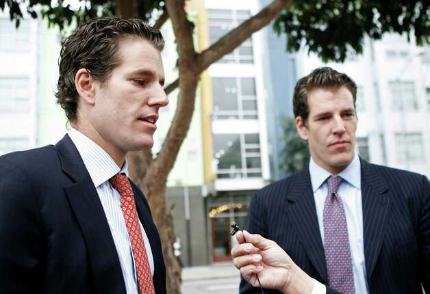 This January 11, 2011 file photo shows Cameron (L) and Tyler (R) Winklevoss, founders of social networking website ConnectU, speak to reporters as they leave the US Court of Appeals for the Ninth Circuit in San Francisco after a court hearing in a lawsuit against Facebook Inc. and its founder Mark Zuckerberg in San Francisco. (KIMIHIRO HOSHINO/AFP/Getty Images) Photo: KIMIHIRO HOSHINO / F AFP