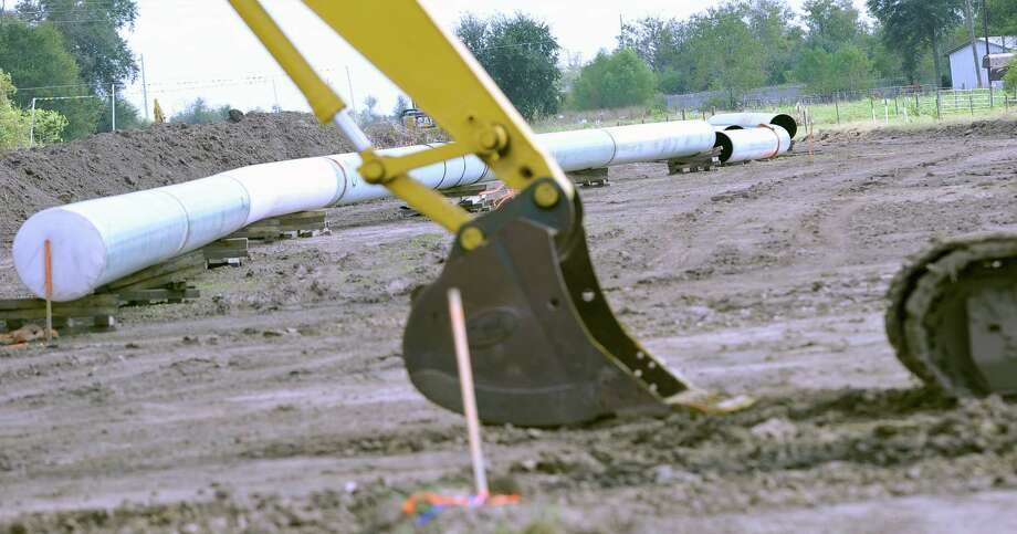 This is the view of the pipe at the work site on S. Pine Island Road near Hwy. 90.  As controversy continues, and protesters continue to protest the Keystone XL pipeline in East Texas, ground work on the project has begun in Southeast Texas. Pipe can be seen laying on the ground on a section of land near the intersection of Walden and Smith Roads, and S. Pine Island Road near Hwy. 90. Dave Ryan/The Enterprise
