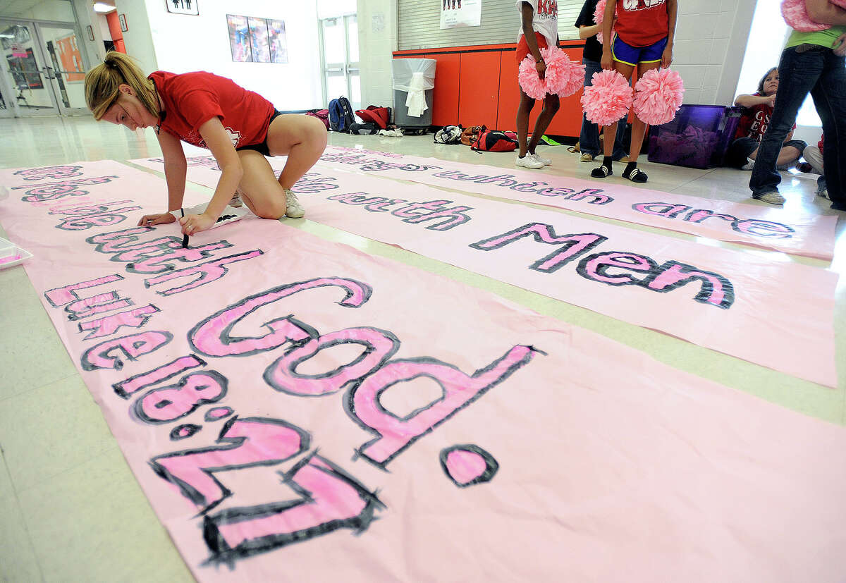 Texas Attorney General Greg Abbott said Tuesday that he supports the religious expression of the Kountze cheerleaders and the district's attorney's who claim the Texas Education Code is unconstitutional. Kountze cheerleader Cassie Page, 14, creates a banner Wednesday for Friday's football game. Photo taken Wednesday, October 17, 2012 Guiseppe Barranco/The Enterprise