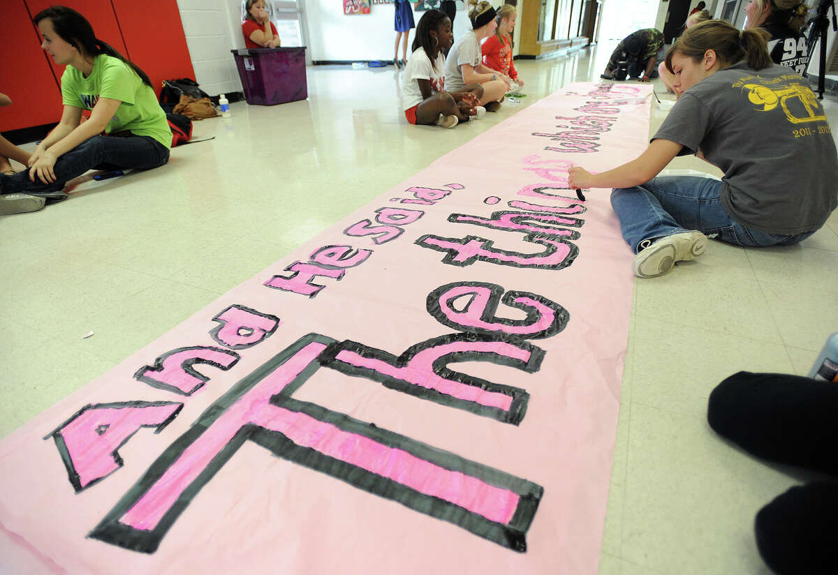 Texas Attorney General Greg Abbott said Tuesday that he supports the religious expression of the Kountze cheerleaders and the district's attorney's who claim the Texas Education Code is unconstitutional. Kountze cheerleader Meagan Tantillo, 17, creates a banner Wednesday for Friday's football game. Photo taken Wednesday, October 17, 2012 Guiseppe Barranco/The Enterprise