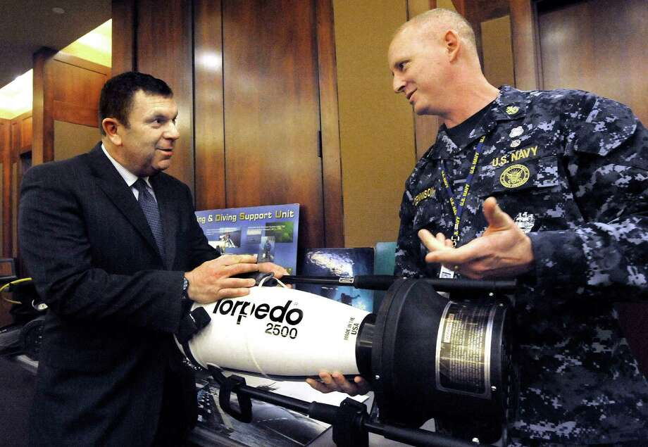 Dr. David Charash, conference host, left, talks with Chief Navy Rescue Diver James Dennison about a diver's propulsion unit in a display of dive equipment at a Diving Medicine Conference at Danbury Hospital Saturday, April 14, 2012. Photo: Michael Duffy / The News-Times