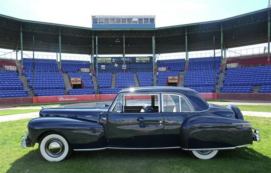 In this photo taken Oct. 9, 2012, a 1948 Lincoln Continental is photographed in Amarillo, Texas. The car belonged to baseball great George Herman Babe Ruth. Ford Motor Co. presented Ruth a new Lincoln Continental in 1948 as a measure of its appreciation for his tireless devotion to Little Leaguers and baseball. (AP Photo/The Amarillo Globe News, Roberto Rodriguez) Photo: Roberto Rodriguez,  (AP Photo/The Amarillo Globe News, Roberto Rodriguez) / Amarillo Globe-News