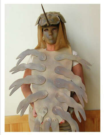 Lynn Hamlen models a Marvelous Mask created by Tammy Hawkins. This and other masks will be displayed during the Darien Nature Center's open house Hoot and Howl on Sunday, Oct. 28, from 4 to 6 p.m. Photo: Contributed Photo