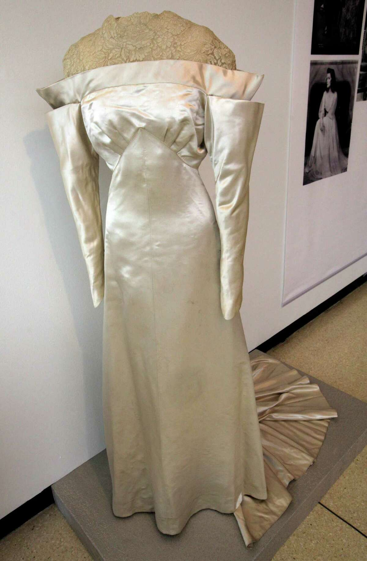 A white satin and lace wedding dress by Howard Greer, from the 1934 production of