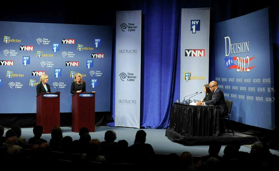 Sen. Kirsten Gillibrand, D-N.Y., far left, and Republican challenger Wendy Long debate at Skidmore College in Saratoga Springs, N.Y. on Wednesday, Oct. 17, 2012.   (AP Photo/Tim Roske, Pool) Photo: Tim Roske