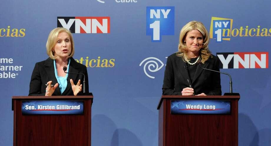 Sen. Kirsten Gillibrand, D-N.Y., left, and Republican challenger Wendy Long debate at Skidmore College in Saratoga Springs, N.Y. on Wednesday, Oct. 17, 2012. (AP Photo/Tim Roske, Pool) Photo: Tim Roske