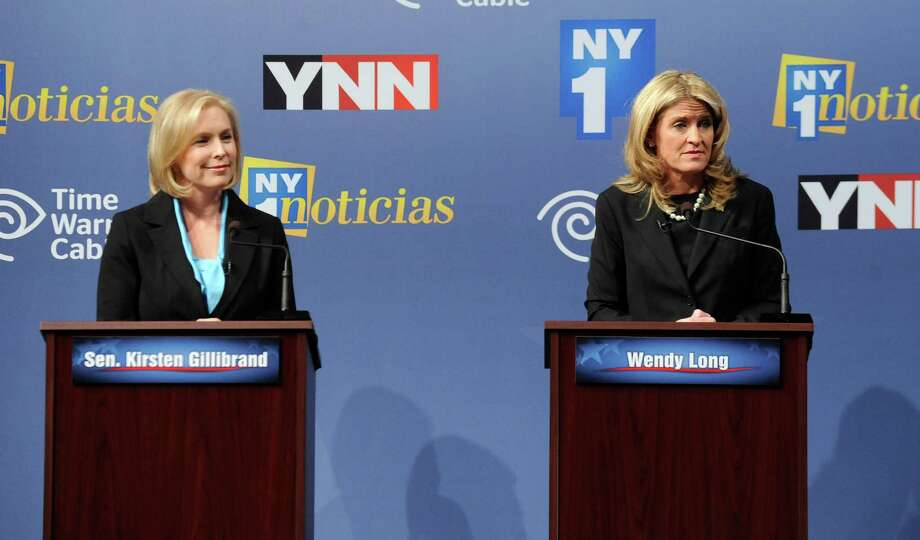 Sen. Kirsten Gillibrand, D-N.Y., left, and Republican challenger Wendy Long, right, appear at a debate at Skidmore College in Saratoga Springs, N.Y. on Wednesday, Oct. 17, 2012. (AP Photo/Tim Roske, Pool) Photo: Tim Roske