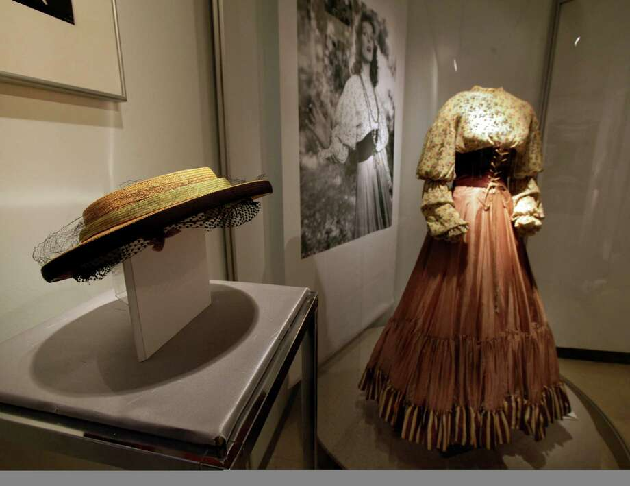"A hat from the 1935 RKO movie ""Alice Adams"" and a dress by Walter Plunkett, from the 1934 RKO movie ""The Little Minister,"" are shown as part of the ""Katharine Hepburn: Dressed for Stage and Screen"" exhibit in the New York Public Library for the Performing Arts at Lincoln Center,  Tuesday, Oct. 16, 2012. Photo: Richard Drew, AP / AP"