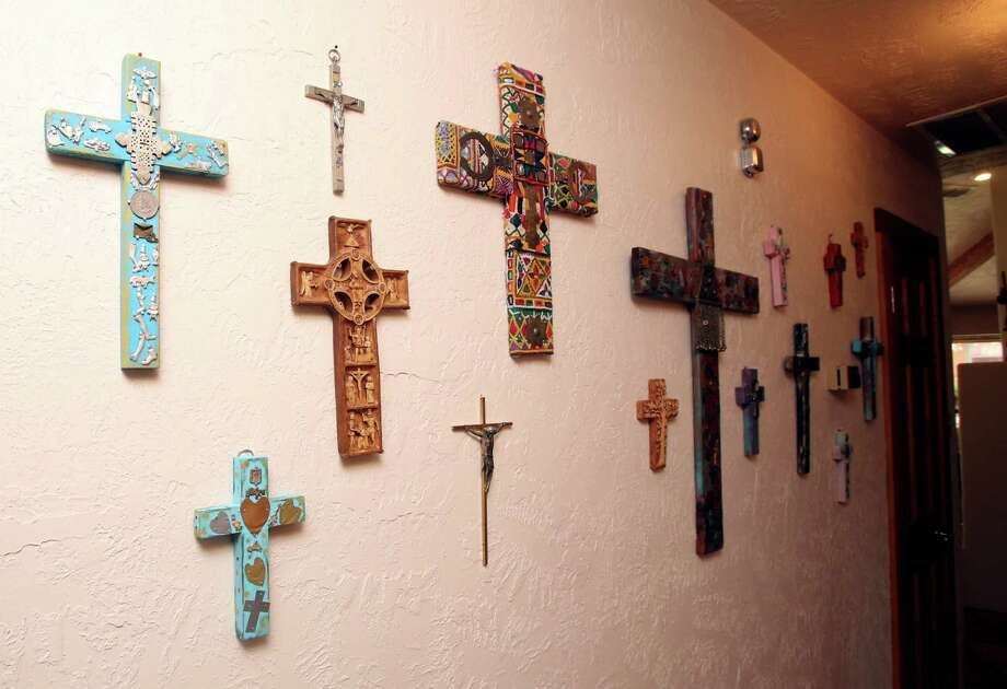 Wall of crosses in the home of Mary and Roberto Salmon reflects his  heritage and her love of the hand-made. Photo: Helen L. Montoya, SAN ANTONIO EXPRESS-NEWS / SAN ANTONIO EXPRESS-NEWS