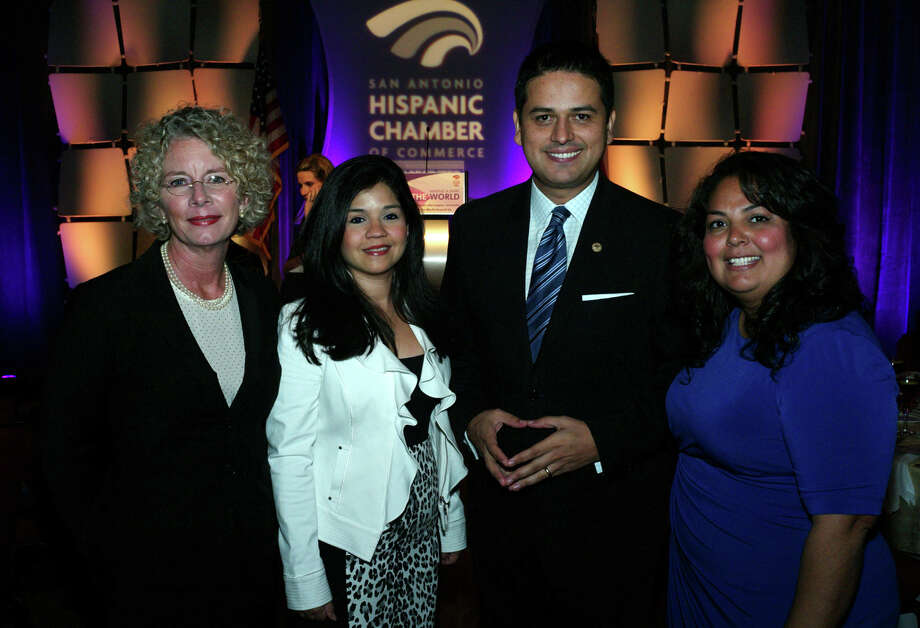 OTS/HEIDBRINK - Honorees Kim Abernethy, from left, Laura Tamez, Hispanic Chamber board chairman Raul Lomeli and honoree Julissa Carielo gather at the Hispanic Chamber of Commerce 3rd Annual Women's Awards Luncheon at the Grand Hyatt Hotel on 10/16/2012. names checked photo by leland a. outz Photo: LELAND A. OUTZ, SPECIAL TO THE EXPRESS-NEWS / SAN ANTONIO EXPRESS-NEWS