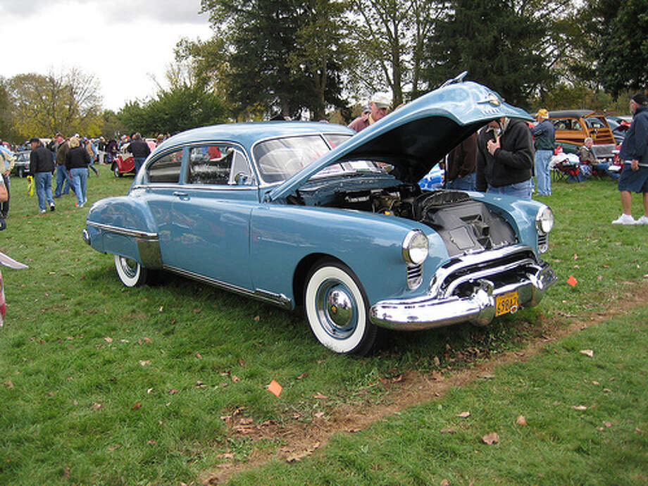 14. 1949 Oldsmobile 88: This car helped define performance for the next decade. Its 303-cubic-inch Rocket V8 engine help boost its horsepower to 165. (Photo: Hugo90, Flickr) Photo: .