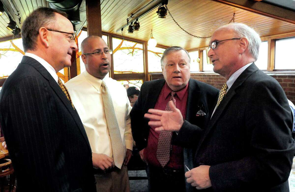 Civic leaders discuss bringing greater rail transportation to Connecticut during a meeting in Danbury Thursday, Oct. 18, 2012. From left are state Sen. Andrew Maynard, Jason Bartlett, Jim RePass, and Ridgefield First Selectman Rudi Marconi.