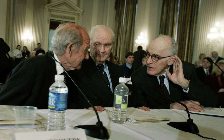 "McGovern,, William Polk, author of ""Understanding Iraq""; and former Army Lt. Gen. William Odom, former director of the National Security Agency as they sit before the Congressional Progressive Caucus forum on, ""The McGovern-Polk plan for U.S. military disengagement from Iraq"" Jan. 12, 2007 in Washington, DC. The forum was held as part of an ongoing effort to examine policy options for achieving U.S. military disengagement from Iraq and bringing U.S. troops home. Photo: Joe Raedle, Getty / 2007 Getty Images"