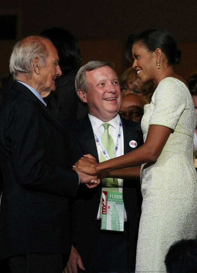McGovern greets Michelle Obama as Sen. Dick Durbin looks on together during day two of the Democratic National Convention (DNC) at the Pepsi Center Aug. 26, 2008, in Denver.  Photo: Justin Sullivan, Getty / 2008 Getty Images