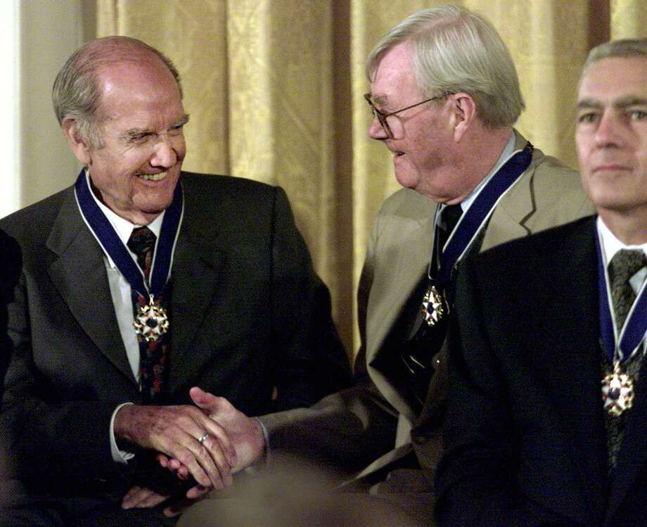 Presidential Medal of Freedom recipients McGovern and Sen. Daniel Patrick Moynihan  congratulate each other during the Presidential Medal of Freedom ceremony in the East Room of the White House 09 August, 2000 in Washington.   (ELECTRONIC IMAGE) Photo: MARIO TAMA, Getty / AFP