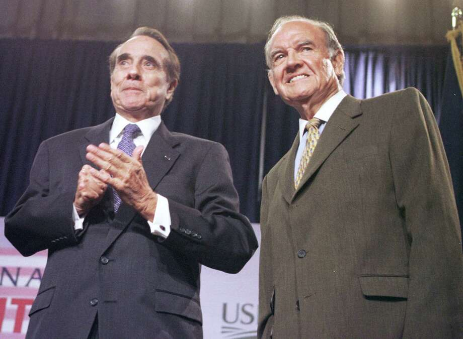 Former senators Bob Dole, left, and George McGovern receive a standing ovation May 30, 2000, at the National Nutrition Summit in Washington, D.C. The summit, the first in 31 years, focused on the need to find new ways to deal with obesity, which affects one in four American adults. (Photo by Michael Smith/Newsmakers) Photo: Michael Smith, G / Getty Images North America
