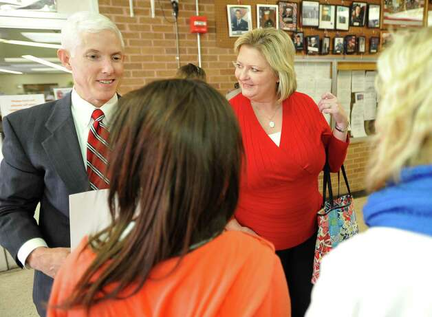Attorney David Starnes, left, meets with cheerleader advisor Beth Richardson, right and cheerleaders Kieara Moffett, front left, and Rebekah Richardson,front right, before leaving the courthouse.   Attorneys were back in the 356 District Court Thursday morning before Judge Steve Thomas. After hearing more arguments, Thomas stated he will make his ruling after lunch. The Kountze cheerleaders extended temporary restraining order expires Thursday, at midnight. Dave Ryan/The Enterprise