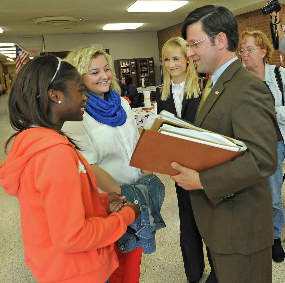 Senior Counsel for the Liberty Institute J. Michael Johnson, right, talks with Kountze cheerleaders Kieara Moffett, left, and Rebekah Richardson, middle.