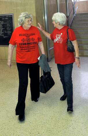 Cheerleader supporters Betty Crowley, left, and Vera Smith, right, leave the courthouse after the judge decided he will announce his decision after lunch. Attorneys were back in the 356 District Court Thursday morning before Judge Steve Thomas. After hearing more arguments, Thomas stated he will make his ruling after lunch. The Kountze cheerleaders extended temporary restraining order expires Thursday, at midnight. Dave Ryan/The Enterprise