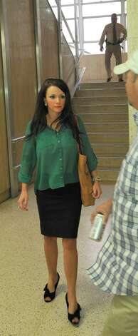Cheerleader mother Coti Matthews leaves the courthouse after the judge decided he will announce his decision after lunch. Attorneys were back in the 356 District Court Thursday morning before Judge Steve Thomas. After hearing more arguments, Thomas stated he will make his ruling after lunch. The Kountze cheerleaders extended temporary restraining order expires Thursday, at midnight. Dave Ryan/The Enterprise
