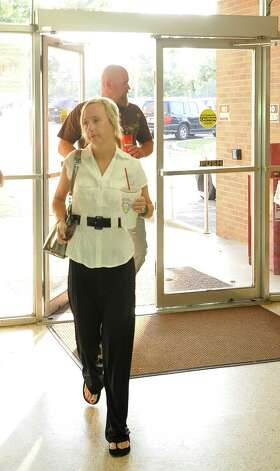 Cheerleader mother Shy Seamans arrives for the hearing. Attorneys were back in the 356 District Court Thursday morning before Judge Steve Thomas. After hearing more arguments, Thomas stated he will make his ruling after lunch. The Kountze cheerleaders extended temporary restraining order expires Thursday, at midnight. Dave Ryan/The Enterprise