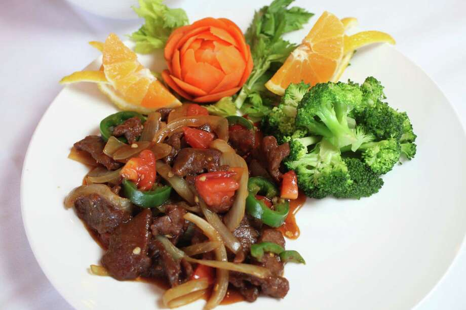 House of Joy Chinese Restaurant, 8407 Bandera Road, Suite 129, 210-521-4551, is preparing a special Valentine's Day menu, $16.95, with several entree choices. Each entree is served with a choice of chicken corn soup or chicken asparagus soup, steamed or fried rice, steamed vegetable medley and complimentary glass of sparkling wine. Photo: JUANITO M GARZA, San Antonio Express-News / San Antonio Express-News